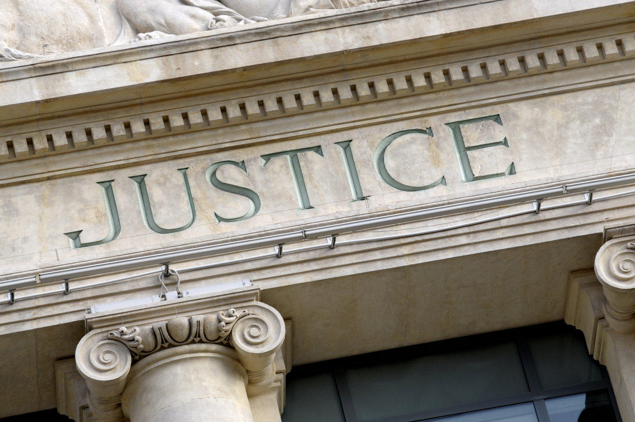 Justice sign on a Law Courts building